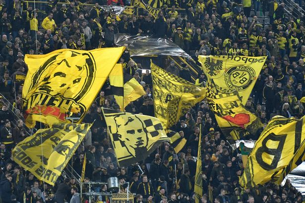 Dortmund fans wave flags prior to the UEFA Champions League round of 16 second leg football match between BVB Borussia Dortmund and Tottenham Hotspur on March 5, 2019 in Dortmund, western Germany.