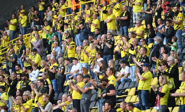 Dortmund's fans applaud during the German first division Bundesliga football match Borussia Dortmund v Borussia Moenchengladbach in Dortmund, western Germany on September 19, 2020