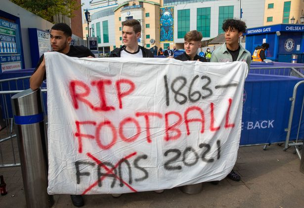 Chelsea fans stage a demonstration outside Stamford Bridge at the proposed formation of a European Super League. Chelsea are one of six English clubs who are meant to be joining the Super league. The fans see it as pure Greed by the owners. Chelsea FC announced this evening that they have withdrawn from the Super League.