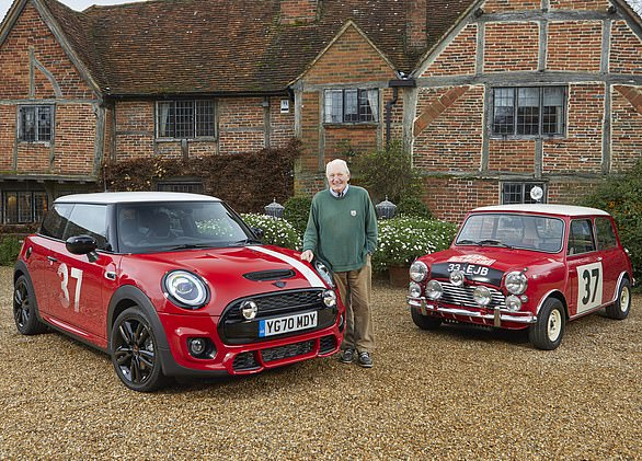 Rally driving legend Paddy Hopkirk , winner of the 1964 Monte Carlo rally, with original and modern Mini Coopers