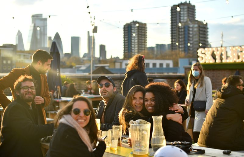 At a London rooftop bar, drinking and laughter return as lockdown eases