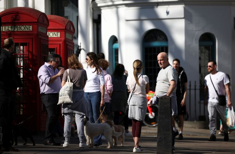 Britons turn positive on UK pandemic response, firms more upbeat - polls