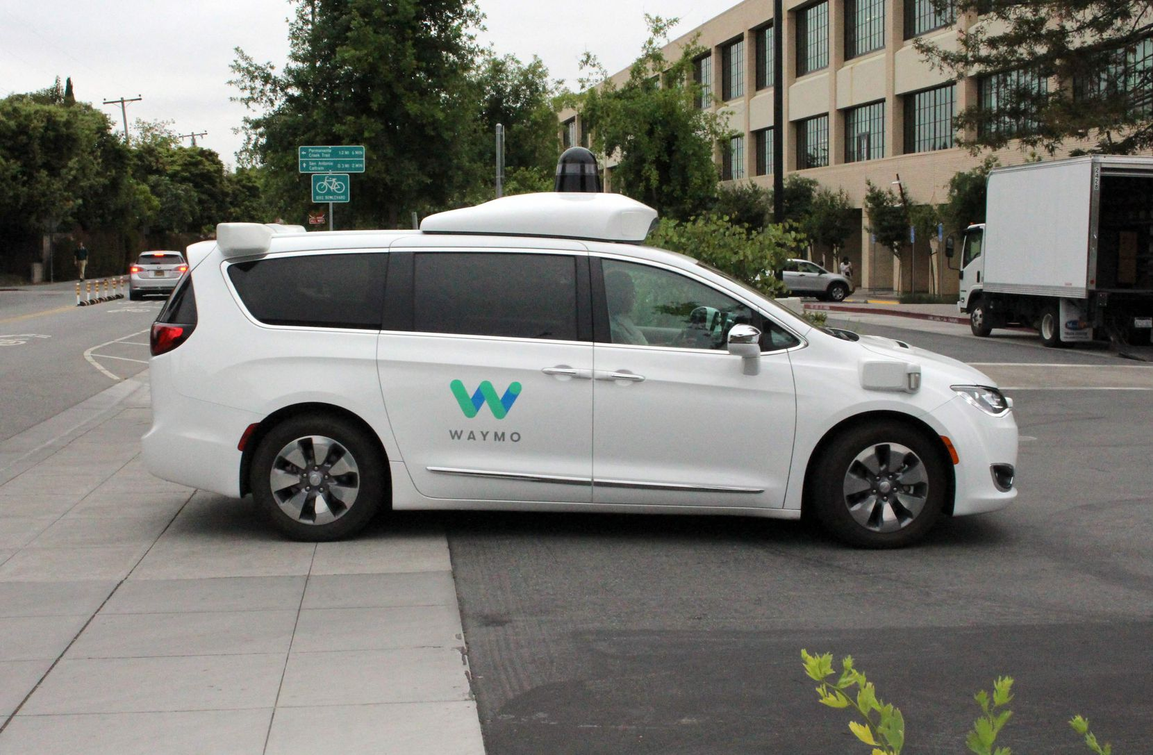 In this 2019 file photo, a Waymo self-driving car pulls into a parking lot at the Google-owned company's headquarters in Mountain View, Calif.