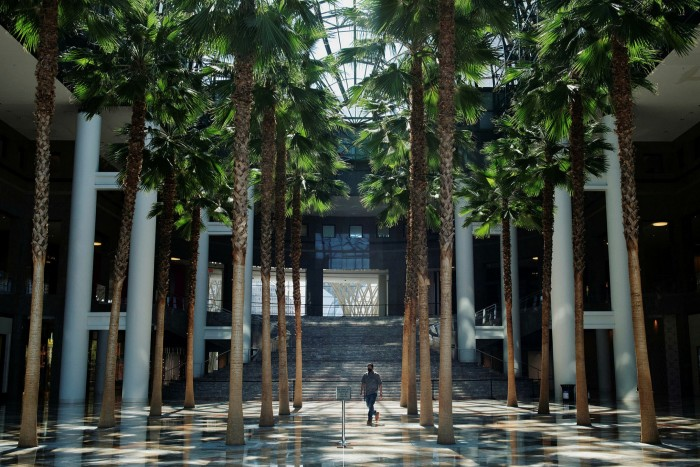 A man walks across the atrium of Brookfield Place, a shopping mall in Manhattan's financial district