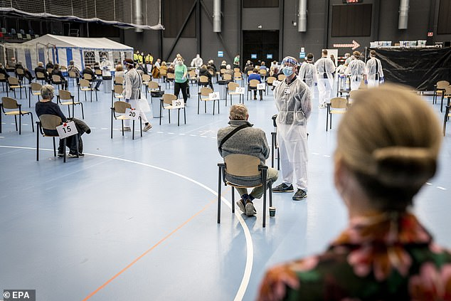 Denmark is looking to swap its unwanted AstraZeneca jabs for other coronavirus vaccines owned by other countries after ditching it entirely over blood clot fears. Pictured: Prime Minister Mette Frederiksen during a visit to the vaccination center in Roskilde Congress Center, Denmark, 12 April 2021