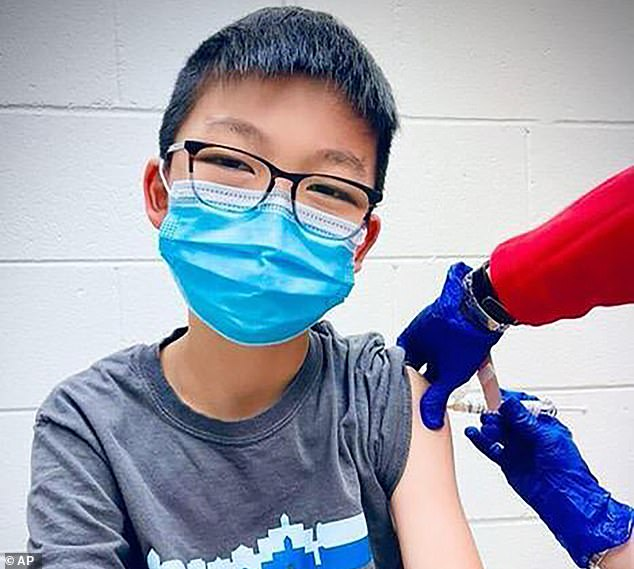 Pfizer Inc has asked the FDA to expand emergency use of its COVID-19 vaccine to Americans between ages 12 and 15. Pictured: Caleb Chung receives the first dose of Pfizer coronavirus vaccine or placebo as a trial participant for kids ages 12 to 15, December 2020