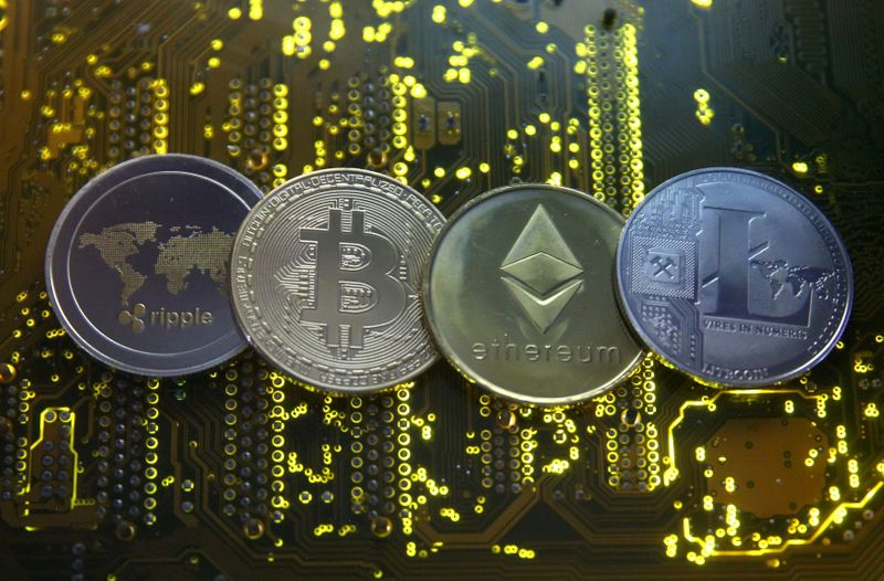 Cryptocurrency market cap hits record $2 trln; bitcoin's at $1.1 trln