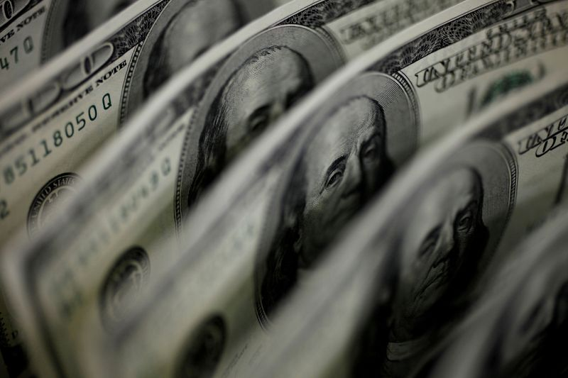 Dollar on defensive as U.S. yields slip on reduced Fed tightening bets