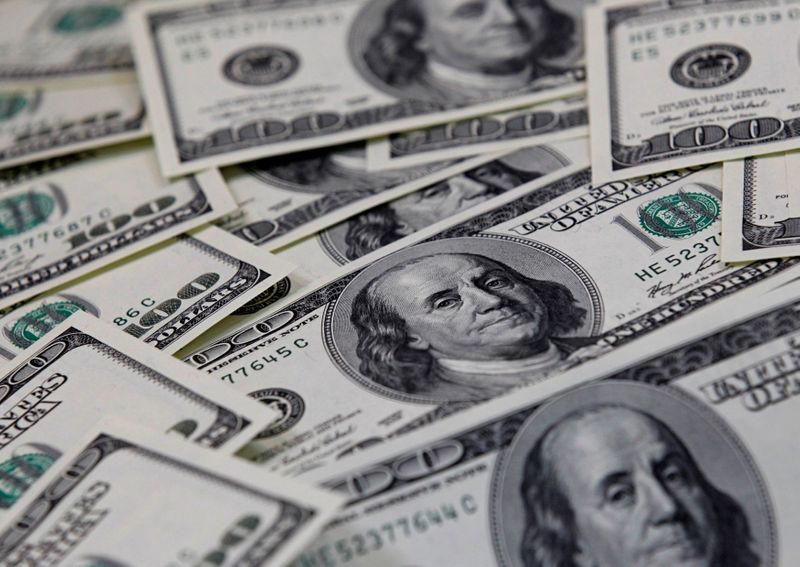 Dollar pinned near one-month low amid subdued U.S. yields