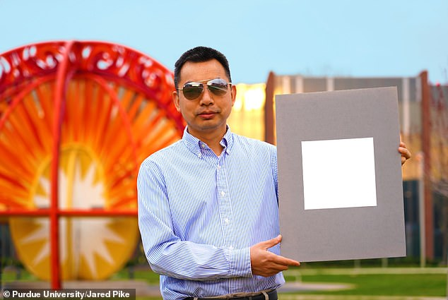 Xiulin Ruan, a Purdue University professor of mechanical engineering, holds up his lab's sample of the 'whitest paint on record'