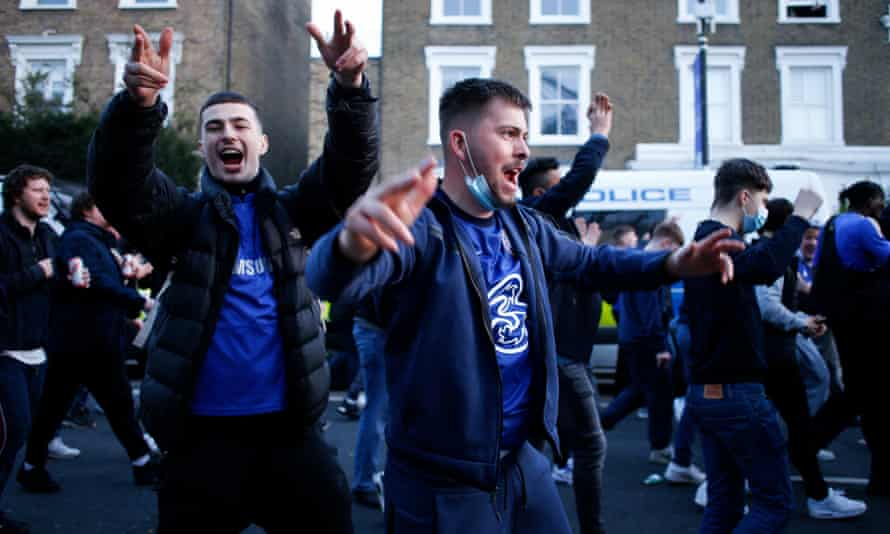 Chelsea fans celebrate after their club announced its intention to withdraw from the European Super League. Football fans were united in opposition to the new competition.