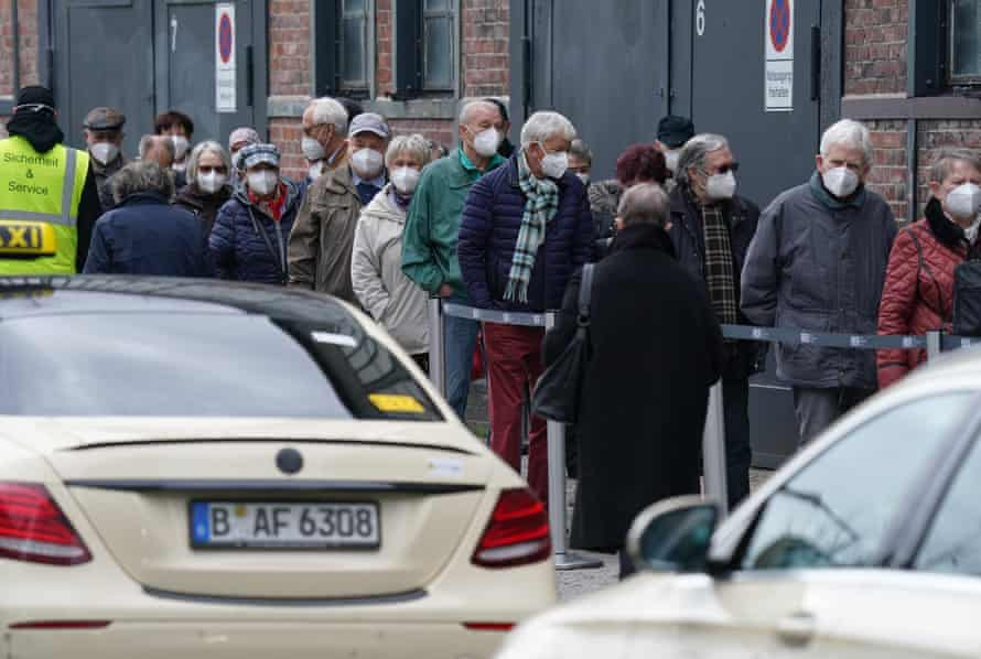 People line up outside a vaccination centre in Berlin
