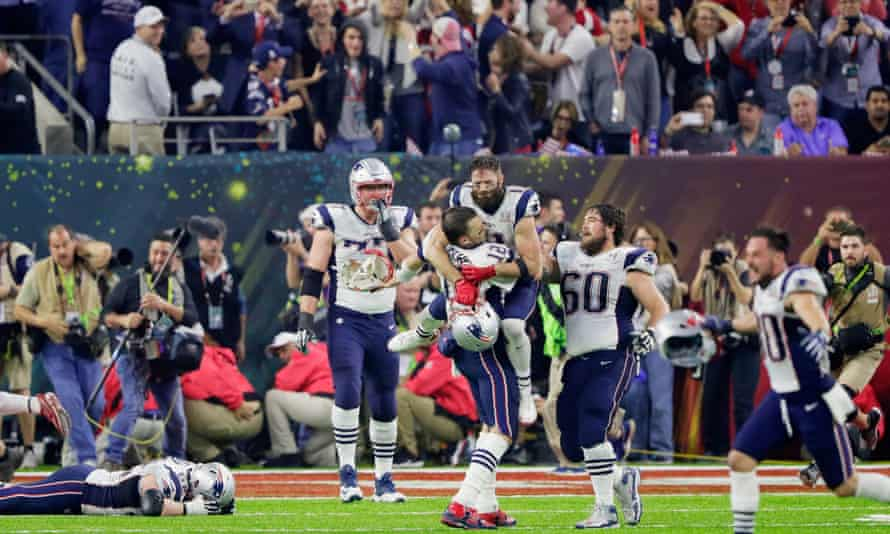 Julian Edelman celebrates with Tom Brady after the Patriots' incredible comeback victory in Super Bowl 51.