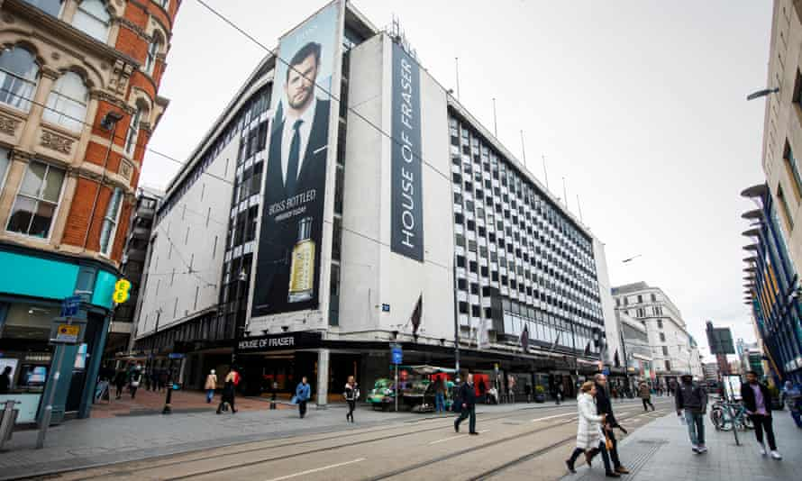 A large white modernist building draped with large House of Fraser banners