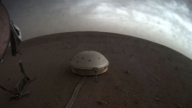 Clouds drift over the dome-covered seismometer, known as SEIS, belonging to NASA's InSight lander, on Mars. Pic: NASA/JPL-Caltech