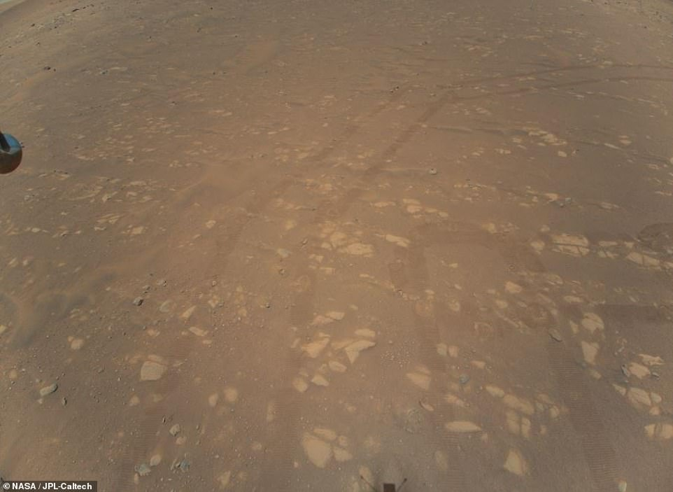 NASA has shared the first color aerial images of the surface of Mars that were taken by Ingenuity during its second successful flight through the Martian atmosphere. The historic photographs were captured while the helicopter hovered 17 feet above the surface while it travels away from Perseverance, but manages to snap the rover's tire marks