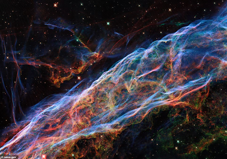 An enhanced image of the Veil Nebula showsfiner details of delicate threads and filaments of ionized gas left over from a massive star that exploded more than 10,000 years ago. The image, originally taken by the Hubble Space Telescope in 2015, was treated with new processing techniques
