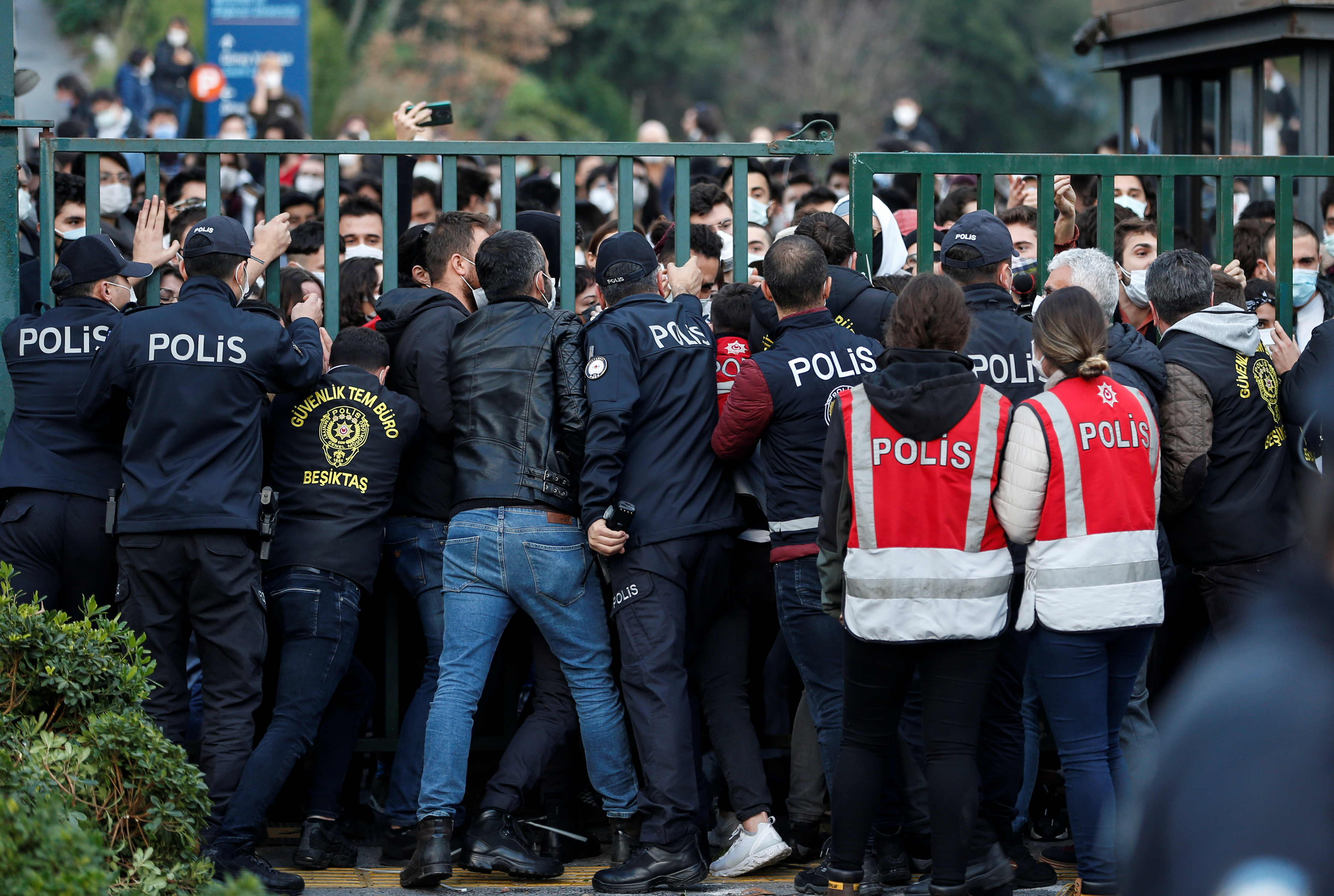 Turkish riot police blocks the main gate of Bogazici University to prevent students from leaving the campus as they protest against President Tayyip Erdogan's appointment of a new rector in Istanbul Turkey January 4, 2021. REUTERS/Kemal Aslan