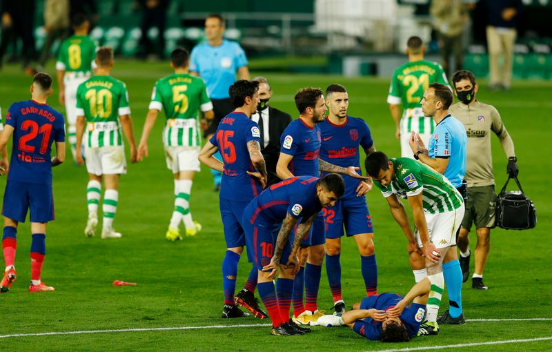 Soccer-Atletico draw at Betis while picking up more injuries