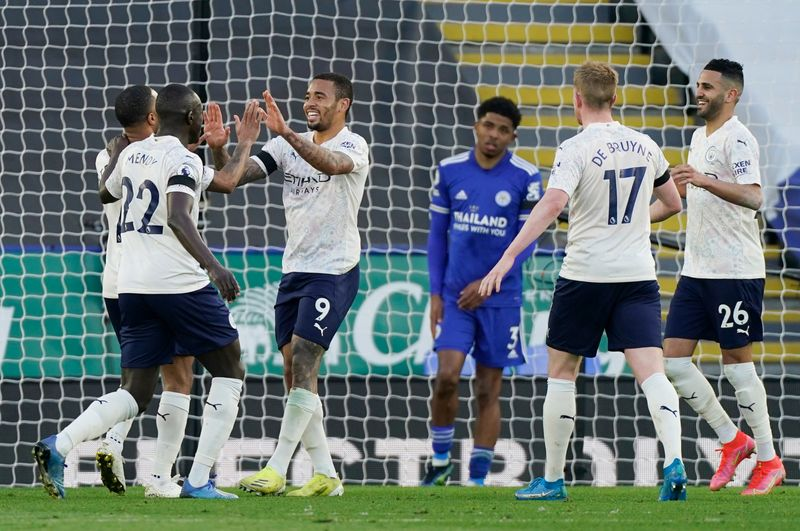 Soccer-Man City back in the groove with win at Leicester