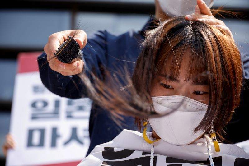 South Korean students shave heads in protest over Japan's nuclear waste water plan