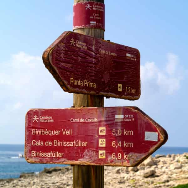 Signpost on the Cami de Cavalls walking route, which follows the coast around Menorca, Balearic Islands,Spain,Europe.