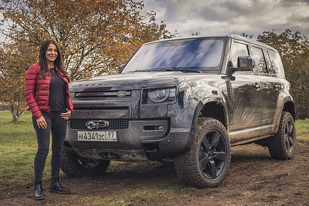 Top spot: Car guru Ginny Buckley and the Land Rover Defender which female motoring experts have recently voted the best car in the world