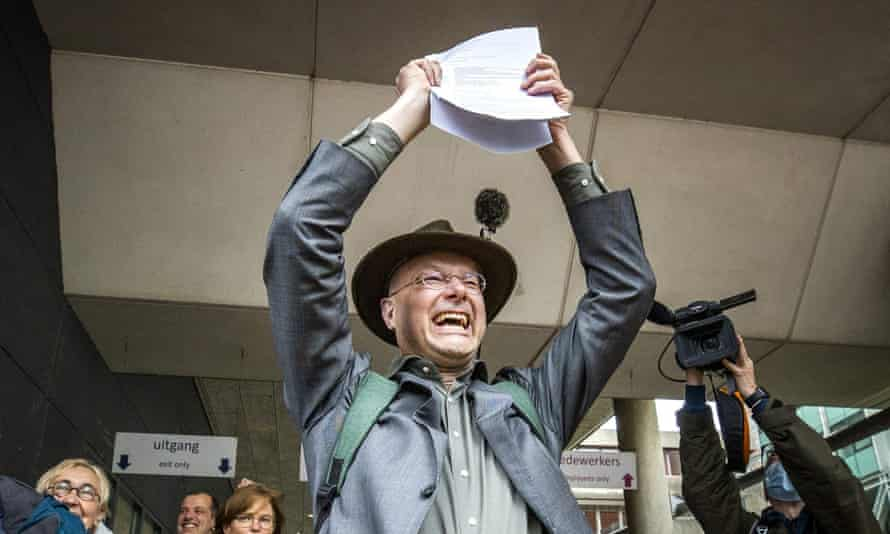 Director of Dutch environment organisation 'Milieudefensie' Donald Pols reacts as he walks outside a court in The Hague.