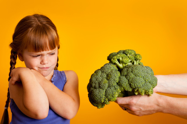 Little Red-Haired Girl Disgusted with Broccoli