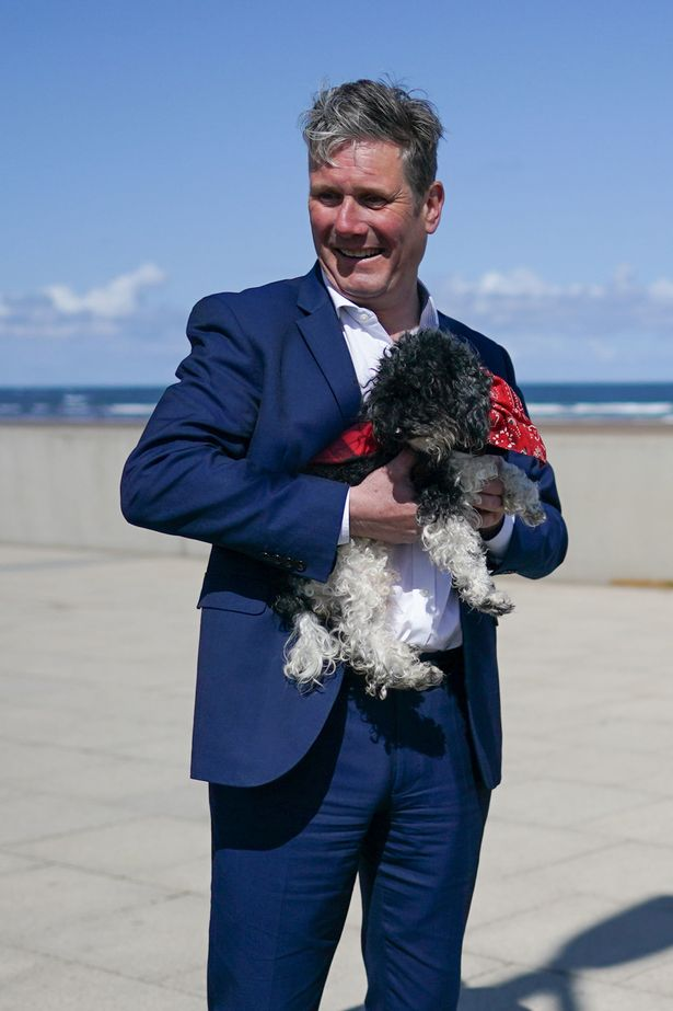 Labour leader Keir Starmer holds a dog as he meets members of the pubic on a walkabout as he visits Seaton Carew seafront while on the election campaign trail. Picture date: Saturday May 1, 2021. PA Photo. Photo credit should read: Ian Forsyth/PA Wire