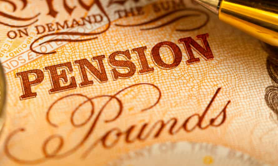 A £10 sterling bank note with the word pension on it next to a ballpoint pen