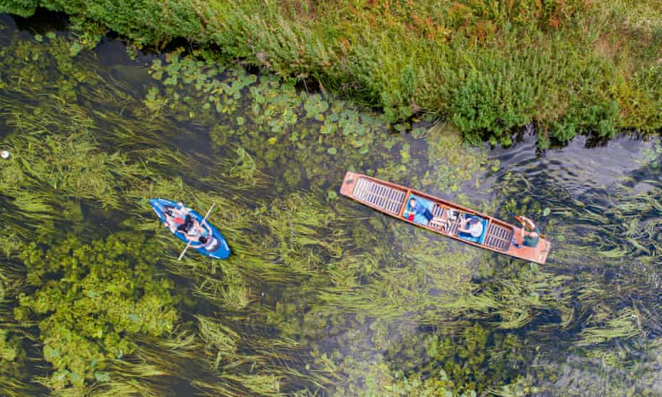 A punt and canoe on the River Cam by Grantchester Meadows.