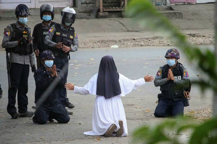 A nun pleads with troops not to shoot protesters