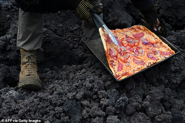 Garcia has to make sure the temperature doesn't get too high and burn the pans and the dough.And if he puts the sheet directly on a lava stream, 'I have to make sure that the pizza doesn't drift away'