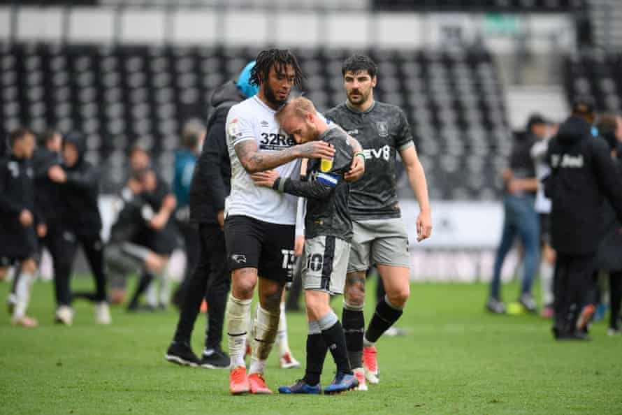 Sheffield Wednesday captain Barry Bannan is embraced by Colin Kazim-Richards after the Owls were relegated at Derby on the final day of the season.