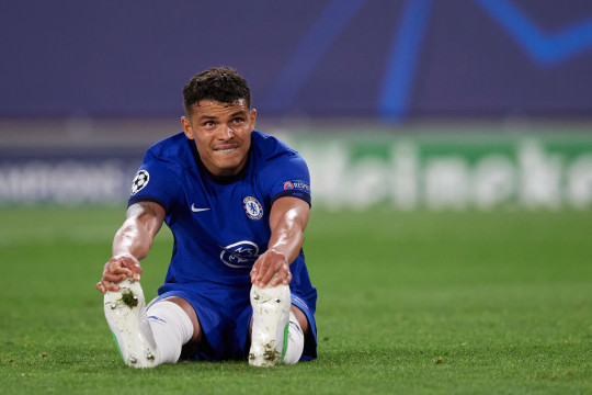 Thiago Silva of Chelsea lies injured on the pitch during the UEFA Champions League Quarter Final Second Leg match between Chelsea FC and FC Porto at Estadio Ramon Sanchez Pizjuan on April 13, 2021 in Seville, Spain. Sporting stadiums around Spain remain under strict restrictions due to the Coronavirus Pandemic as Government social distancing laws prohibit fans inside venues resulting in games being played behind closed doors.