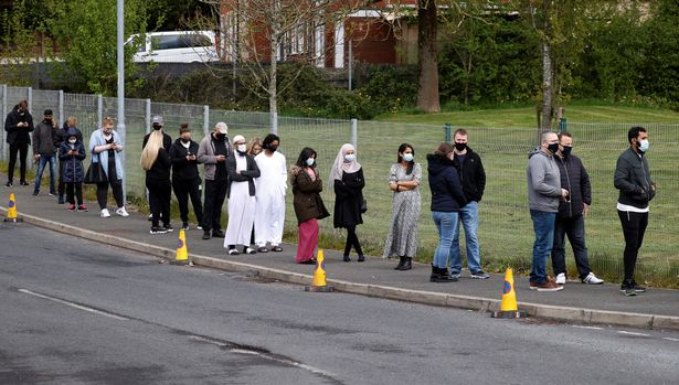 Queues at a mobile vaccine centre in Bolton