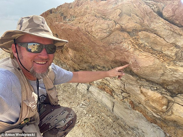 Dr Anton Wroblewski points to an underprint made 58 million years ago by a heavy mammal (likely Coryphodon) walking on the deltaic deposits above. Underprints form when sediment is displaced downward by footsteps from heavy animals