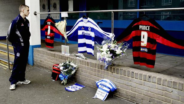 A fan looks at tributes to Mark Prince at QPR's stadium in 2006