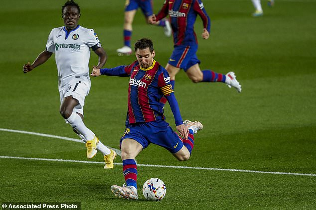 FC Barcelona was one of the riskiest sports teams to use as a password, as well as Liverpool FC. Pictured,Lionel Messi shots and scores the opening goal versus Getafe in April