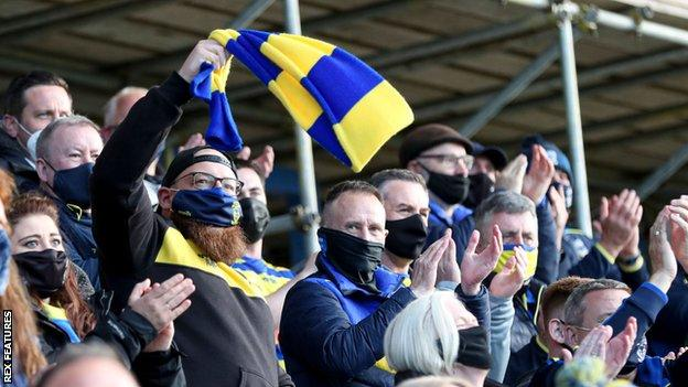 Only home fans were permitted inside the Halliwell Jones Stadium