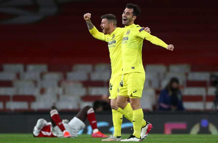 Alberto Moreno celebrates with Manu Trigueros (right) after Villarreal knock out Arsenal to reach the Europa League final.