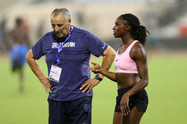 Asher-Smith works with coach John Blackie in Doha during 2019 World Championships