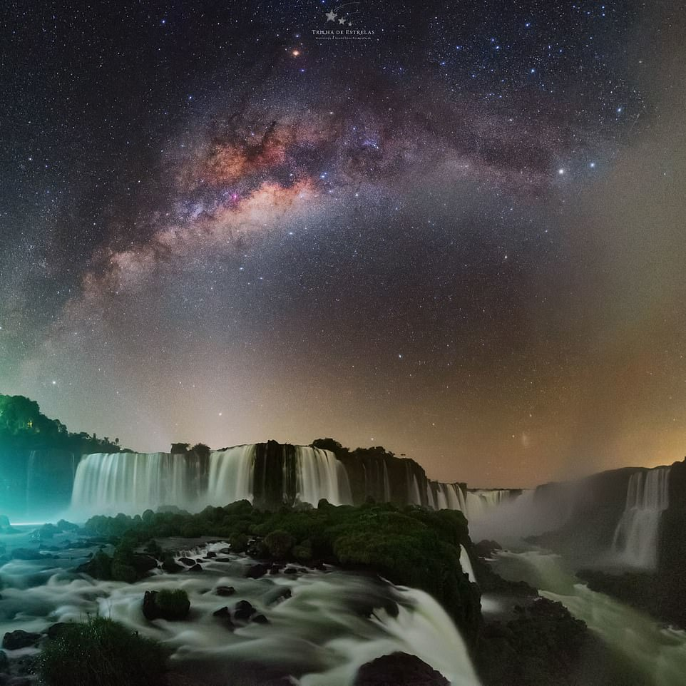 """'Devil's throat'— by Victor Lima atIguazu Falls, Brazil. Mr Lima said: 'In this image, we have one of the main waterfalls of the Iguazu Falls complex, the """"Santa Maria Jump"""". Right over the fall, we can see Saturn and the zodiacal light illuminating the horizon. Further up there is the Milky Way Core'"""
