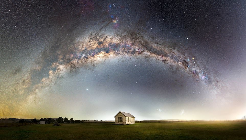 'Heavens above' — by John Rutter. It shows fog clearing to reveal an old church in a paddock in Hunter Valley, New South Wales, Australia. Rutter said: 'That night, the forecast was for terrible weather, so I had written the night off and went home. To my amazement, the skies cleared and it was a race to get back to the location and start shooting!'