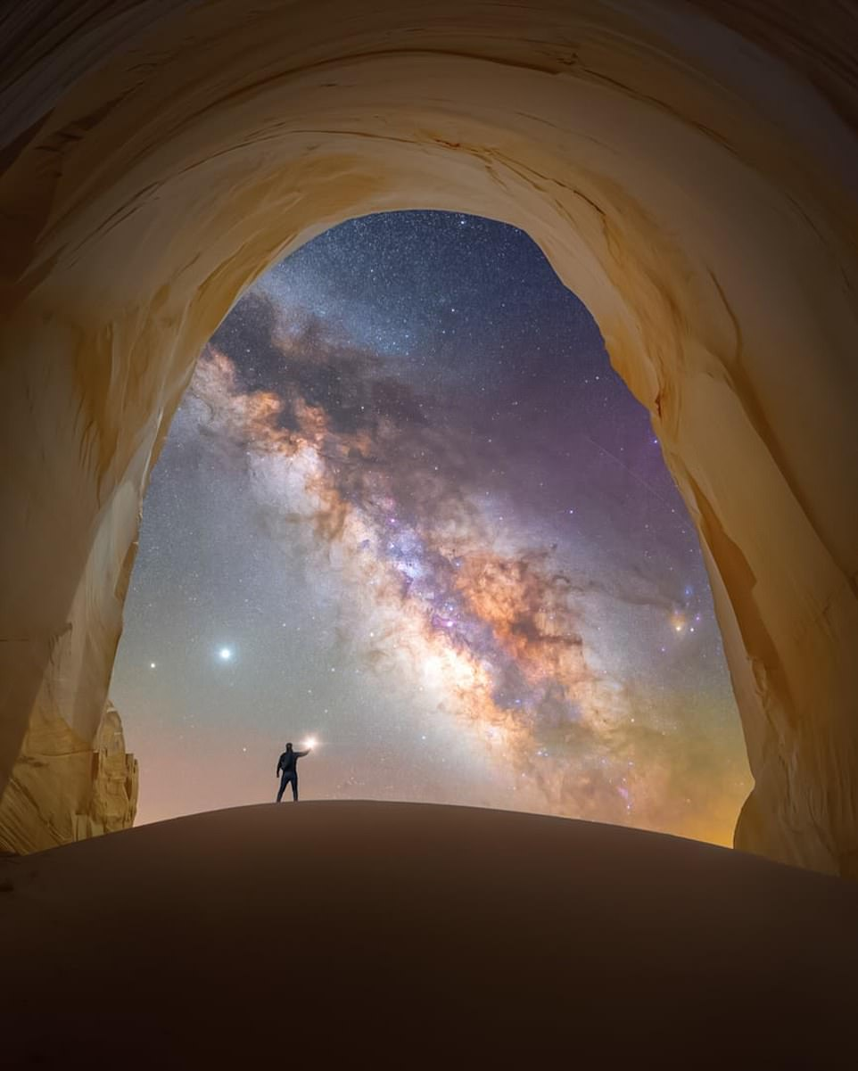 'Chamber of light' — by Spencer Welling below a remote set of cliffs in Grand Staircase-Escalante in Utah, USA. Mr Welling said: 'Due to its remoteness, this natural stone chamber provides some of the clearest, most pristine views of the Milky Way framed by the copper-coloured opening of the cavern'