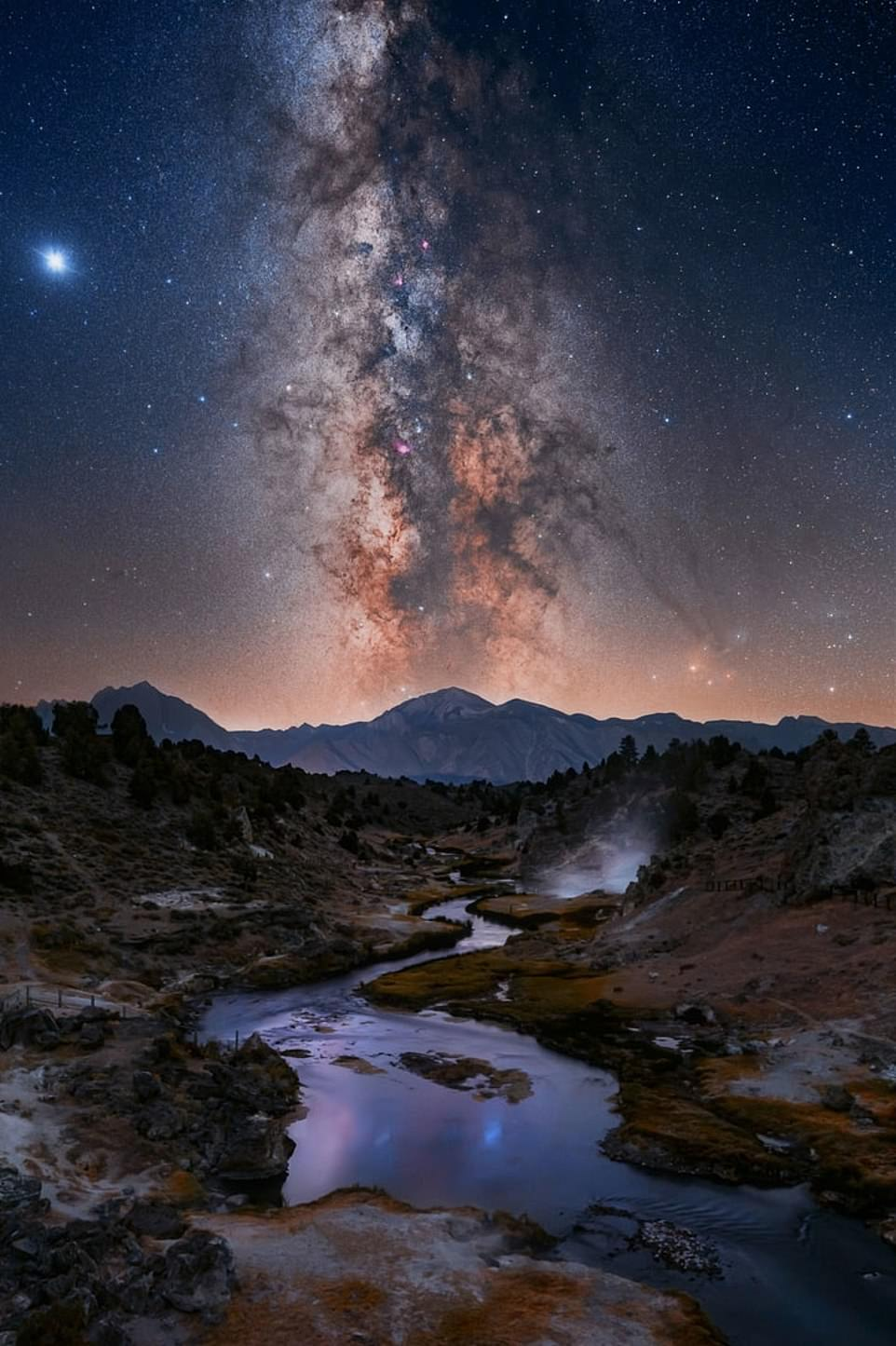 'When all the stars align'— by Kelly Teich in Mammoth Lakes, California. Ms Teich said: 'This particular location, near Mammoth Lakes, is a unique spot where the vertical alignment of the Milky Way's Galactic Core sits perfectly over a mountain peak and a creek with natural hot springs flowing into it. You really couldn't ask for a better foreground to work with!'