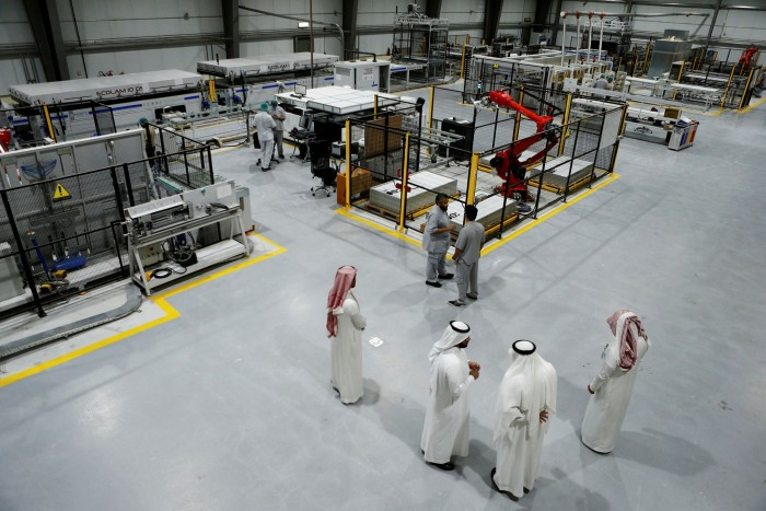 Workers at a solar plant factory nearRiyadh. Saudi Arabia's Crown Prince Mohammed bin Salman has warned that duringthe energy transition, 'if we do not maintain our savings and distribute our tools every day, we will be transformed into a poorer country'