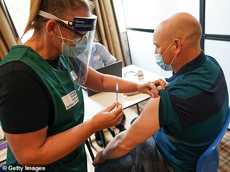 The vaccine rollout today opened up to everyone aged 30 and over in England (Pictured: A man gets his jab in Hexham, Northumberland)