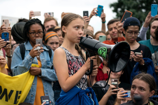 WASHINGTON, DC - SEPTEMBER 13: Teenage Swedish climate activist Greta Thunberg delivers brief remarks surrounded by other student environmental advocates during a strike to demand action be taken on climate change outside the White House on September 13, 2019 in Washington, DC. The strike is part of Thunberg's six day visit to Washington ahead of the Global Climate Strike scheduled for September 20. (Photo by Sarah Silbiger/Getty Images)